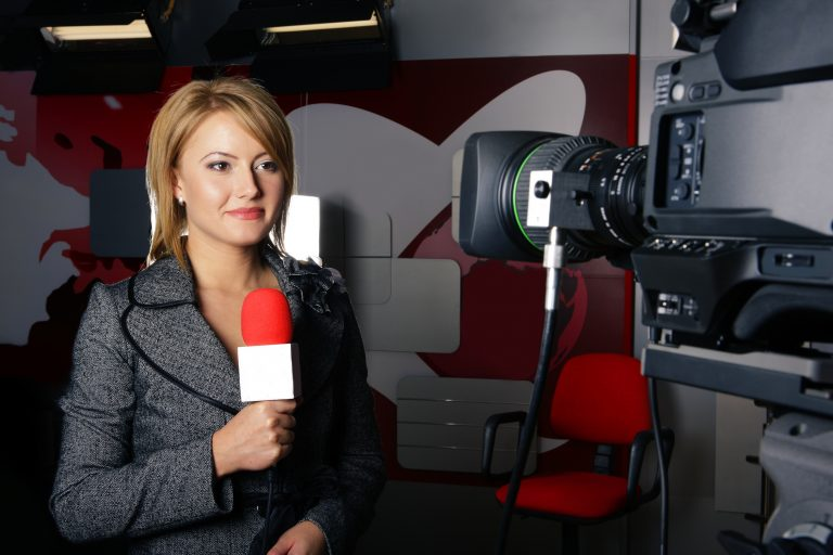live television transmission and smiling reporter